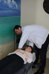 Dr Dohoney nashua chiropractor treating patient