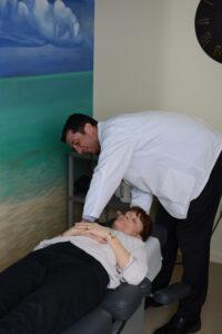 Dr Dohoney nashua chiropractor treating patient