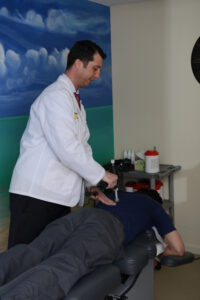 Dr. Dohoney Nashua Chiropractor treating patient